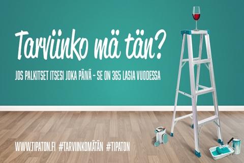 """Rakennustikkaat, jonka päällä on punaviisilasi. Kuvassa teksti """"Tarviinko mä tän? Jos palkitse itseni joka päivä -se on 365 lasia vuodessa. www.tipaton.fi, #tarviikomätän #tipaton""""."""